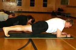 Participants in an adult yoga class